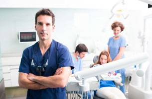 multiple dentists standing around Dental Care Center