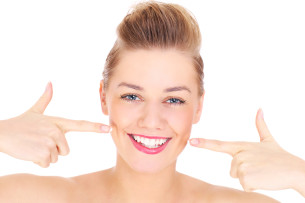 smiling woman do you have white spots on teeth Dental Care Center