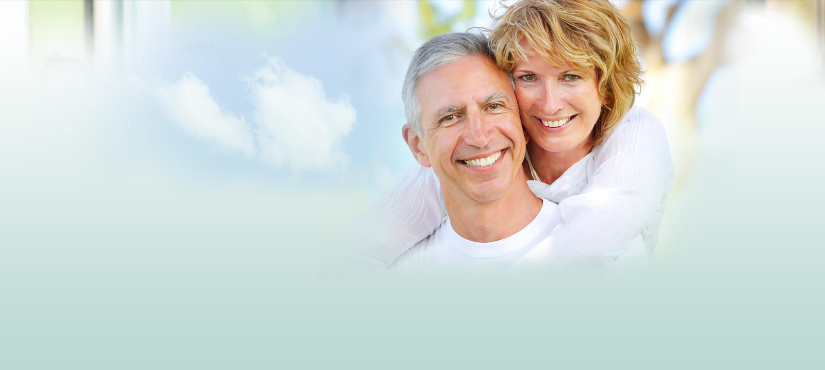 husband and wife hugging Dental Care Center