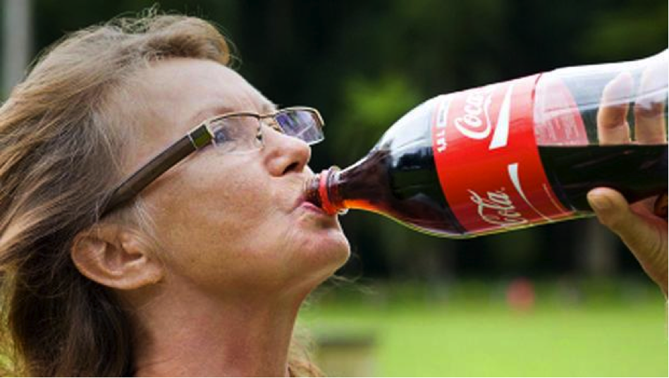 Woman Drinking Soda Dental Care Center