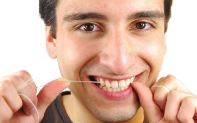 man flossing teeth Dental Care Center