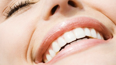 woman smiling Dental Care Center