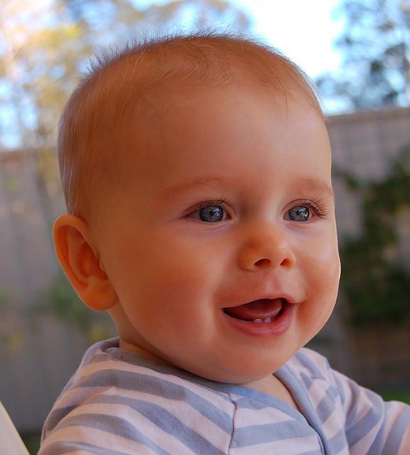 baby smiling Dental Care Center