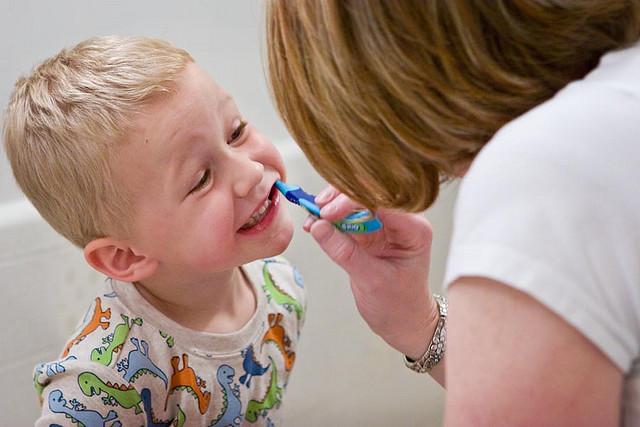 mom brushing child's teeth Dental Care Center