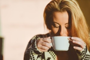woman drinking coffee Dental Care Center