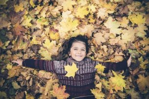 kid in leaves Dental Care Center
