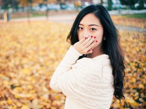 girl covering mouth Dental Care Center