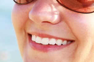 woman smiling Dental Care Center