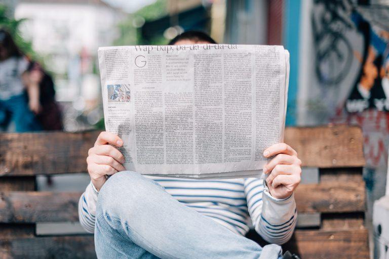 reading-the-newspaper Dental Care Center