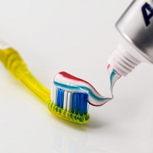 toothbrush and toothpaste Dental Care Center